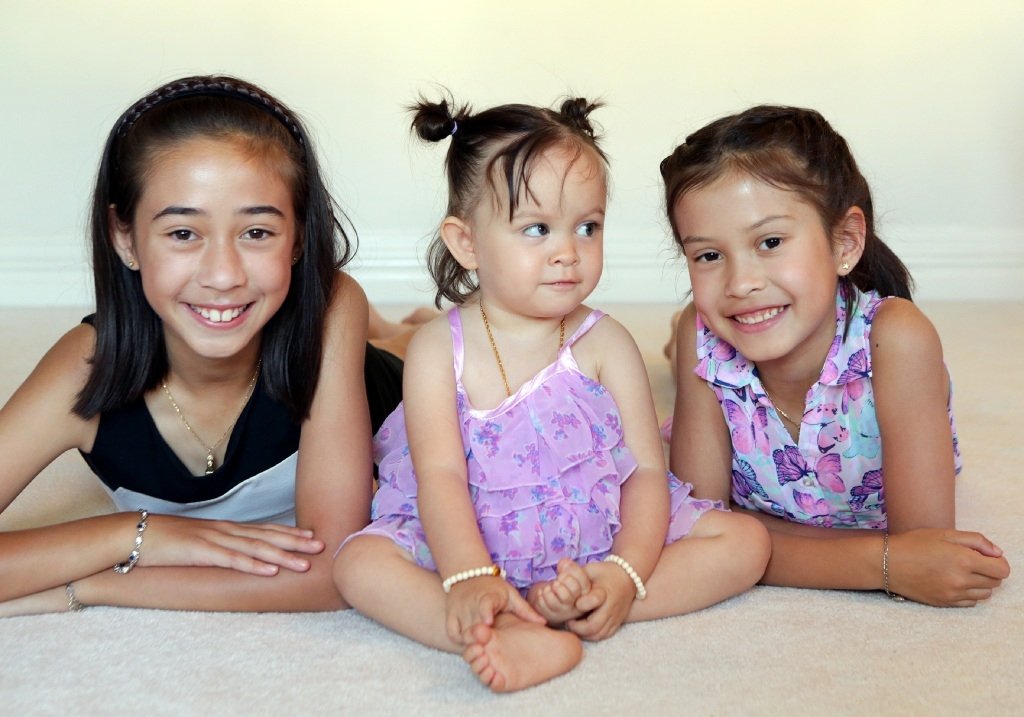 Sisters Nina Malkos, Mia Wilkes and Ellie Malkos.Picture: Martin Kennealey        www.communitypix.com.au   d446919
