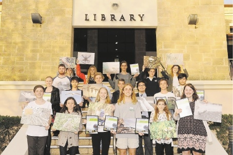 Third placed Zoe Hodgson (second from left), winner Laura Coombes (third from left) and second placed Jakob Thompson (fourth from left) with the 19 of the 20 finalists and their entries.