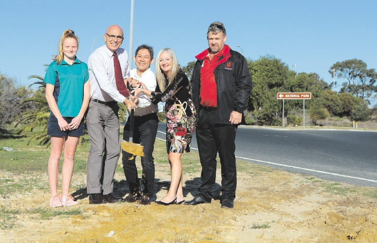 Yanchep Dolphins Little Athletics Club's Chloe Parker with John Quigley, Gin Wah Ang, Tracey Roberts and Yanchep Red Hawks Football Club president Les Porter.