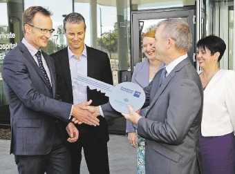Health Minister Kim Hames (on right) hands the keys to the hospital over to Lachlan Henderson (St John of God Health Care Executive Director Perth Northern Hospitals). Picture: David Baylis