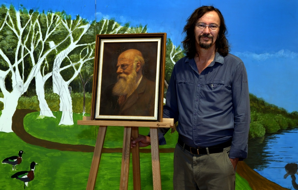 Mike Bamford with a self-portrait by his great-grandfather Alfred John Bamford. Picture: Martin Kennealey www.communitypix.com.au d446664
