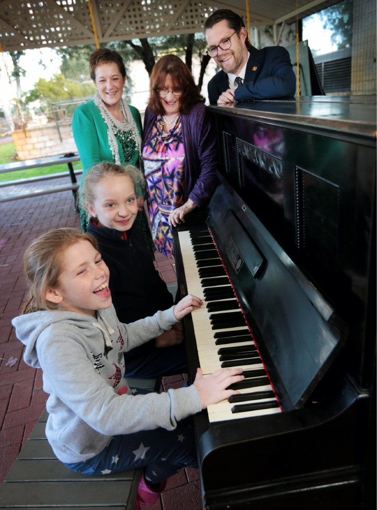 Students Lilijanna Daly and Ava Neville play the piano for principal Sonya Barrett, Pauline Christidis, who donated the piano and Cr Dan Bull. Picture: David Baylis        d456179