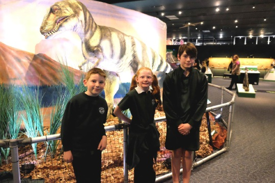 Belmay Primary students Adam Hamling, Alicia Curtis and Cooper Vermeulen with Bucky the dinosaur.