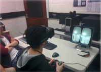Students try out a radiology simulator designed at Murdoch University.