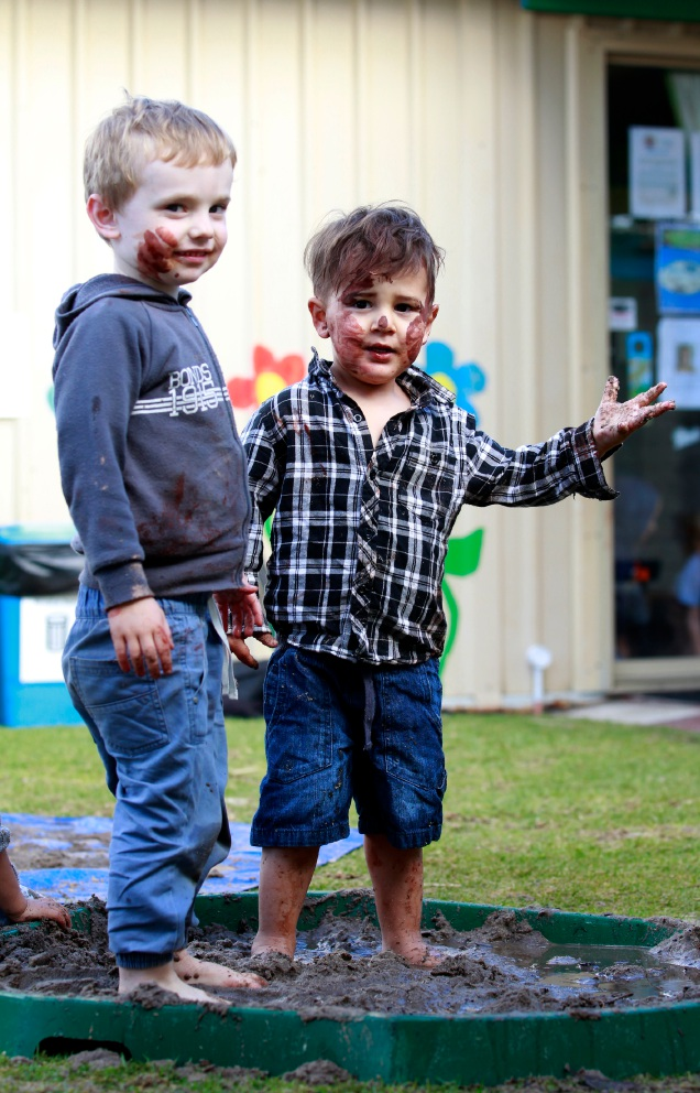 Children get down and dirty with Kian Starcevich (centre) loving getting into the mud.  Picture: Marie Nirme d456136
