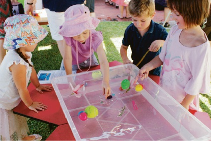 Children at Hensman Street Kindy take part in a science experiment.
