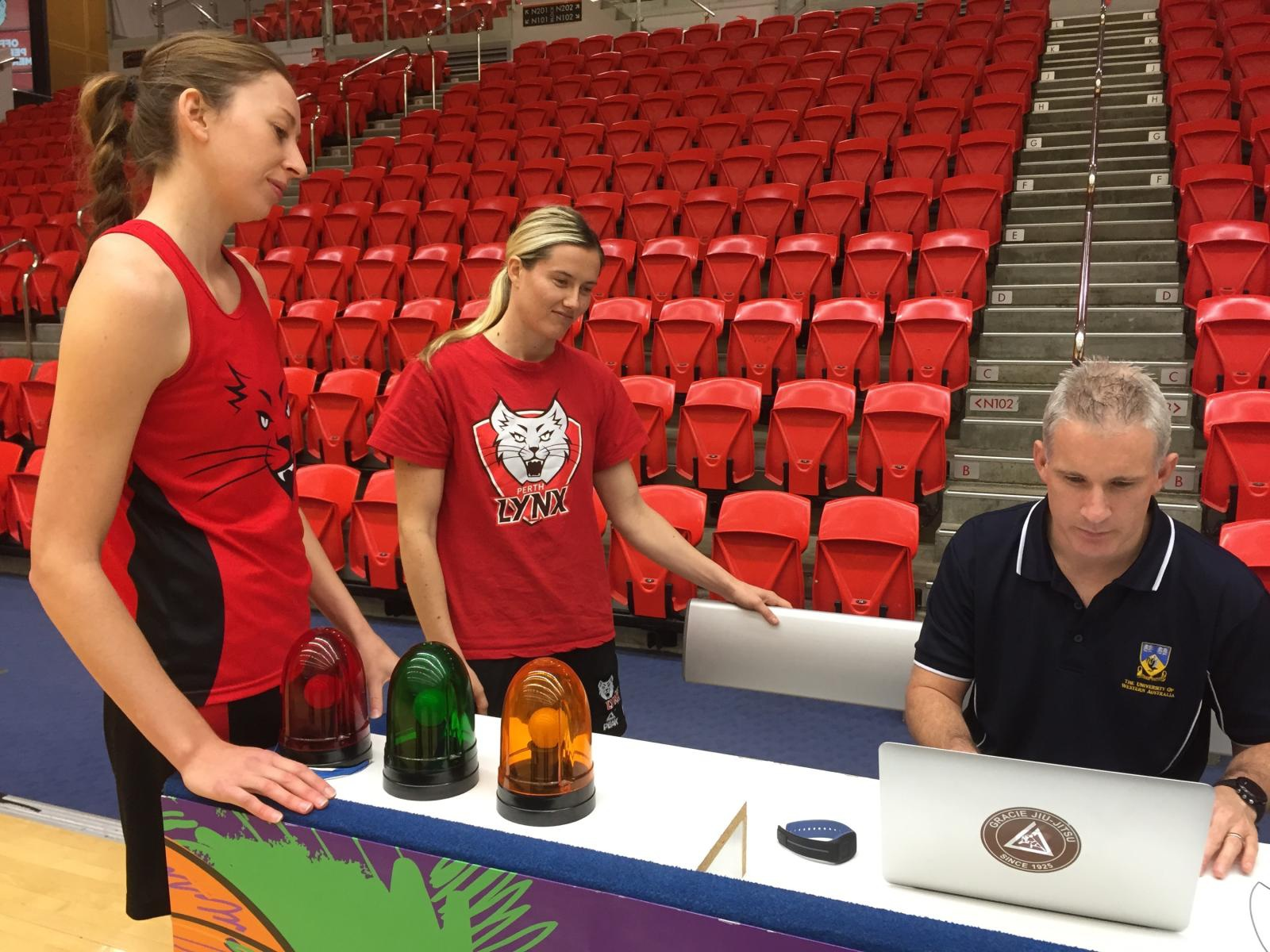 From left: Perth Lynx players Natalie Burton and Sami Whitcomb with UWA's Ian Dunican.