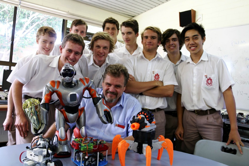 Sacred Heart College teacher Neil Gray with his Year 12 engineering students.