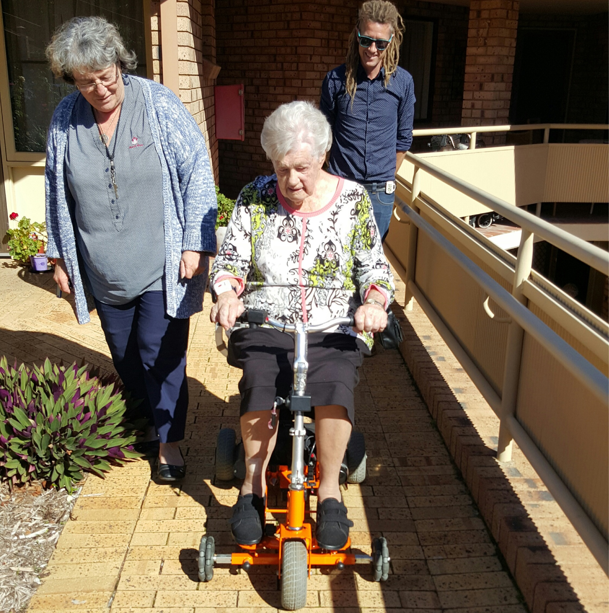 Jay Brown (Veterans services), Dorothy Kennedy on her new mobility scooter, and AYLA Inc founder Scott Johnson.