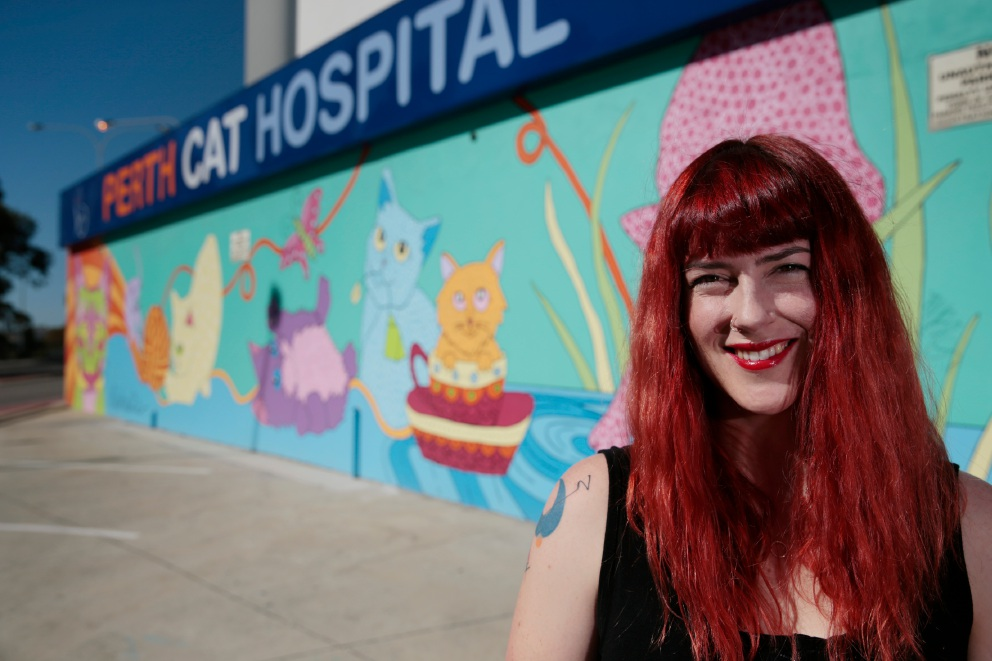 Rahalie McGuiris is selling her artwork for charity at the CORD Fundraiser on May 28. She recently finished a cat mural in West Leederville. Picture: Andrew Ritchie d453750