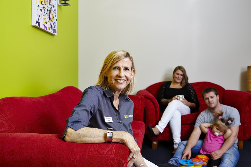 VisAbility psychologist Louise Snowball with a family who use the organisation's services.