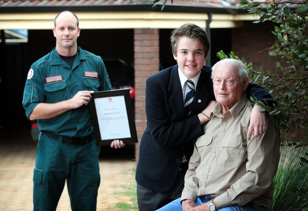 Joel Moore (Area Manager - St John Ambulance) with the Merit Certificate from St John Ambulance for Sebastian Harrup (14) of Forrestfield with his grandad Rod Irvine of Cloverdale.
