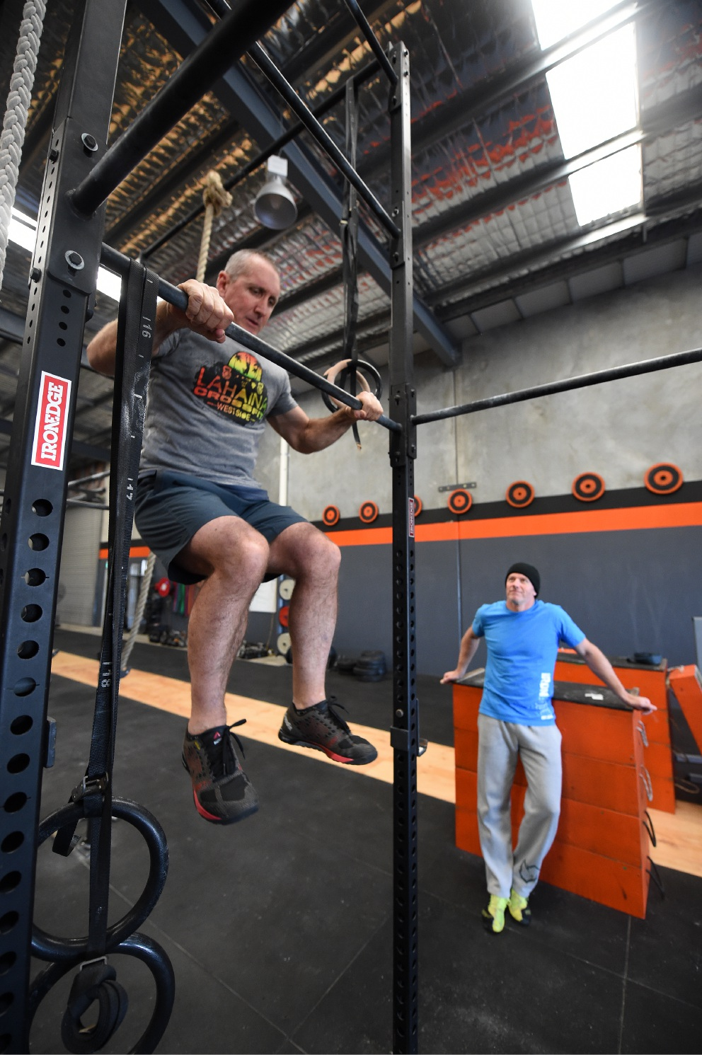 Dave Young (57) is watched by IronBody  Crossfit Port Kennedy co-owner Tony Bartlett. Picture: Jon Hewson  d456206