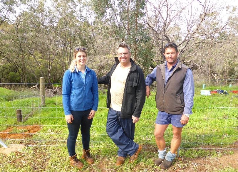 Landholder Cameron Kay with PHCC project officer Jordon Garbellini and fencing contractor Matt Kirkham on the Murray River foreshore.