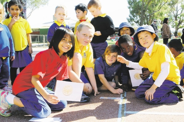 Students make a coin train as part of the school's fundraising activities for the Cancer Council WA. Picture: Marcelo Palacios www.communitypix.com.au   d438647