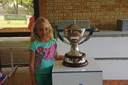 Madison Newbury-Groom (7) with the Hopman Cup. Above right: Ellie Tullis and Matilda Griffiths (both 7).