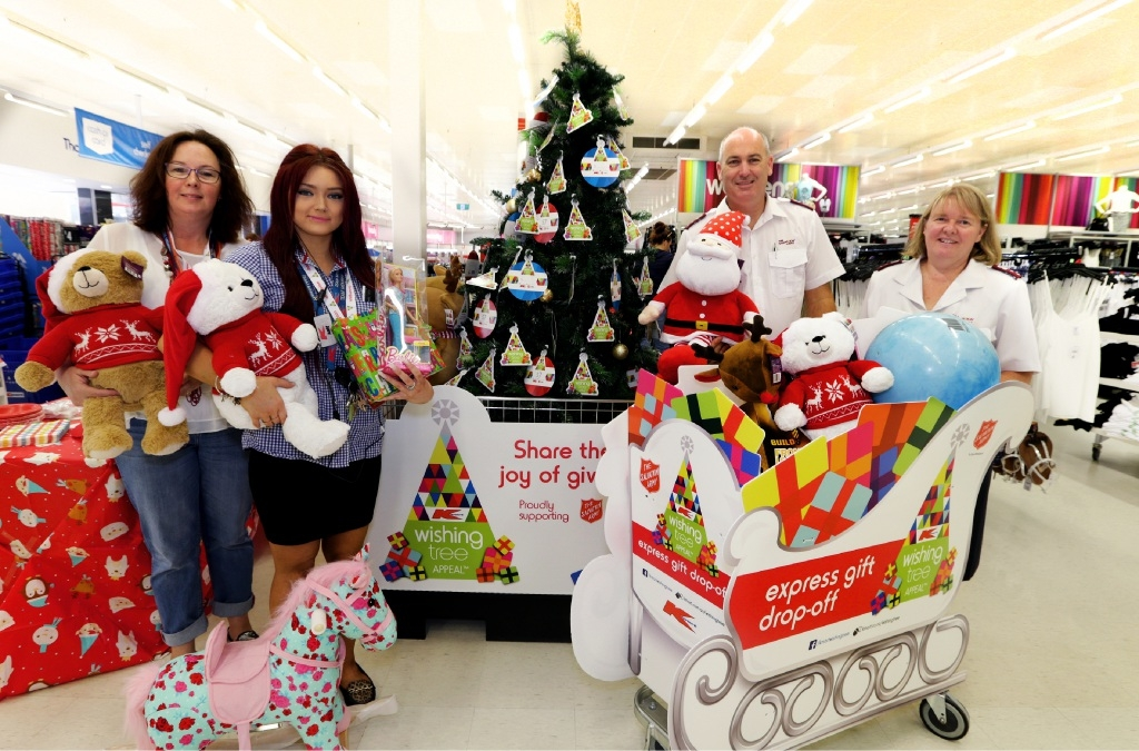 Sandy Stubbs and Amy Reed from Kmart with Captain Scott Norman and Captain Natalie Norman from the Salvation Army Heathridge Corps. Picture: Martin Kennealey          d446722
