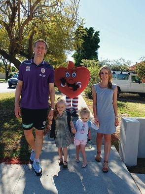 Michael Thwaite with daughters Portia and Madelene and wife Chantelle and the Heart Foundation's mascot Hearty.
