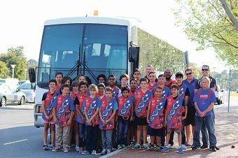 Djinda Falcons members preparing to board a bus at Arena Joondalup for the tour.