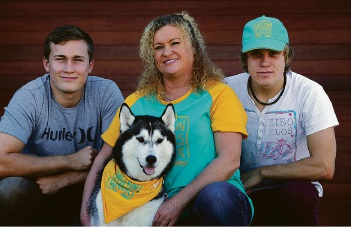 Lynda Henning, of Quinns Rocks, and her sons Luke and Matt with Siberian Husky Miah. Picture: Martin Kennealeyd453718