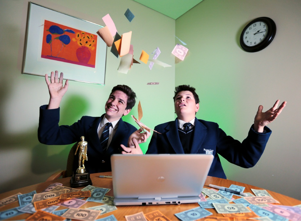 James White and Hayden Della Franca celebrate their stockmarket win at school. Picture: David Baylis.
