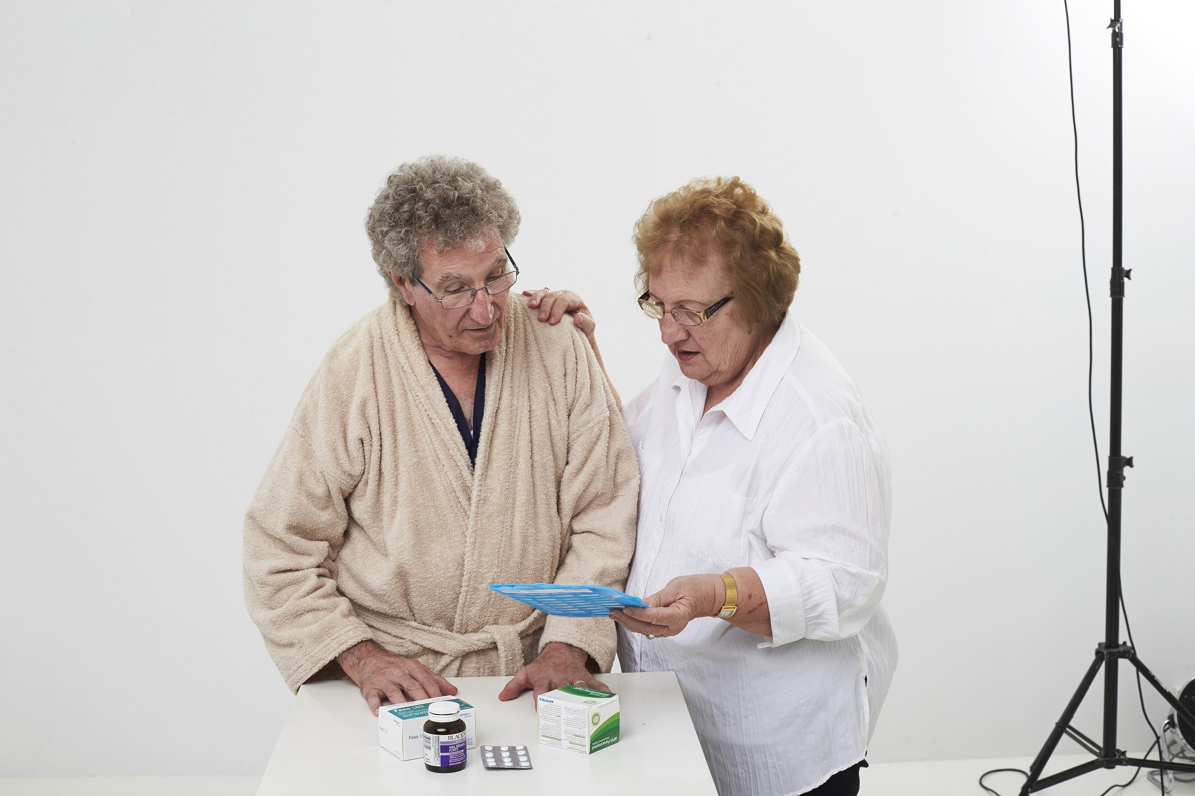 Stay On Your Feet volunteers Frank Medland and Alma Digweed urge people to check their daily medications during the winter season.