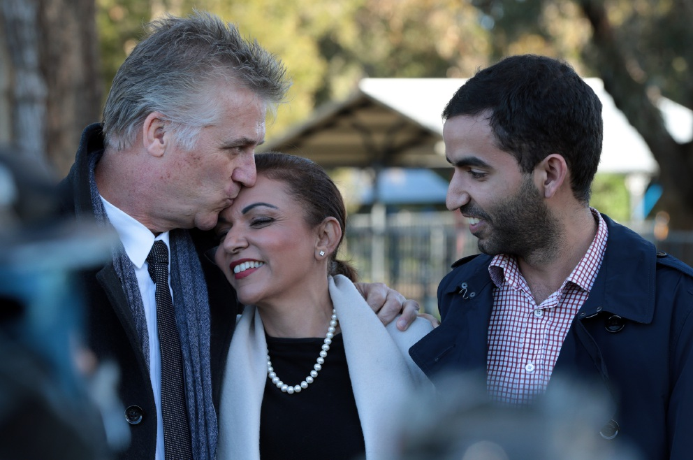 Making history... Labor's Anne Aly gets a kiss from husband David while son Adam looks on. Picture: Martin Kennealey d456835
