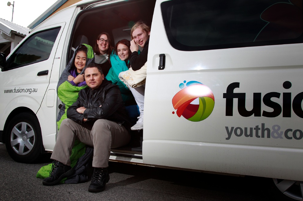 Fusion Perth co-workers Seku Moo, Jessie Braun, Neil Curran (front), Lucy Axton and Tyler Cunningham getting ready for the Sleep In Your Car event. Picture: Marie Nirme