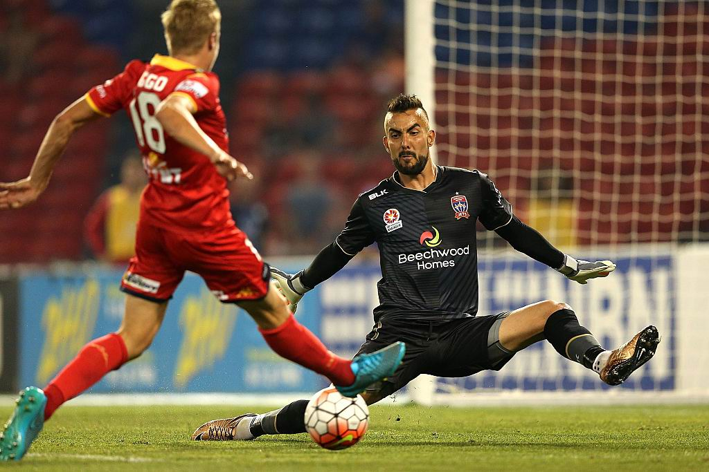 Mark Birighitti saves a James Jeggo effort at Hunter Stadium in December, 2015. Picture: Ashley Feder/Getty Images
