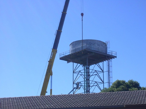 The water tower being dismantled in 2012.