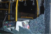 Damage to a bus caused by rock-throwing.