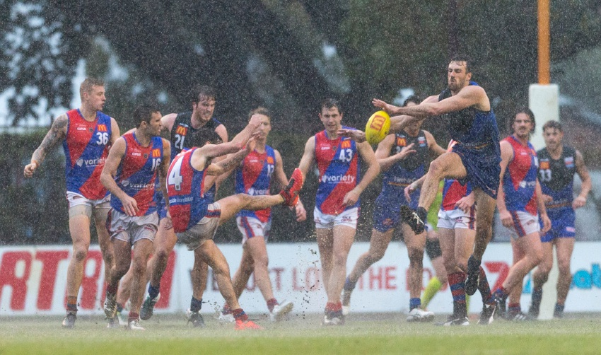 Shane Nelson gets a kick away under pressure from East Perth's Eric Mackenzie. Picture: Dan White