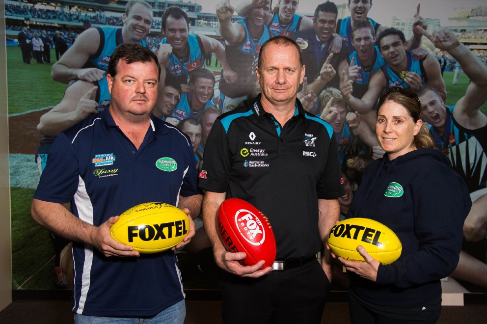 Great learning experience: Hammond Park Junior Football Club's Tom Shaw (left), Port Adelaide Coach Ken Hinkley and Hammond Park Junior Football Club's Kara Craig.