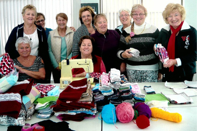 The Timber's Edge craft group with some of the items they are sending to Uganda.
