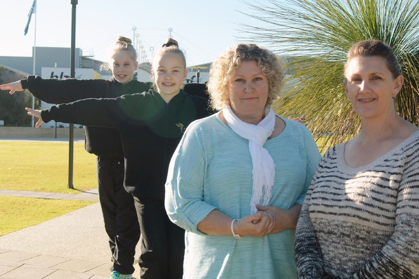 Floreat parents Rebecca Fiori (left) and Nadine Entwhistle moved for their daughters Lara (front) and Mikala to attend WAIS. Picture: Jon Bassett