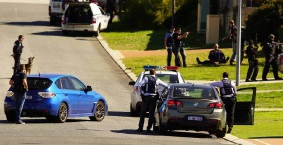 Various police teams stand guard as a man is detained in Alexander Heights. Picture: Matt Beilken