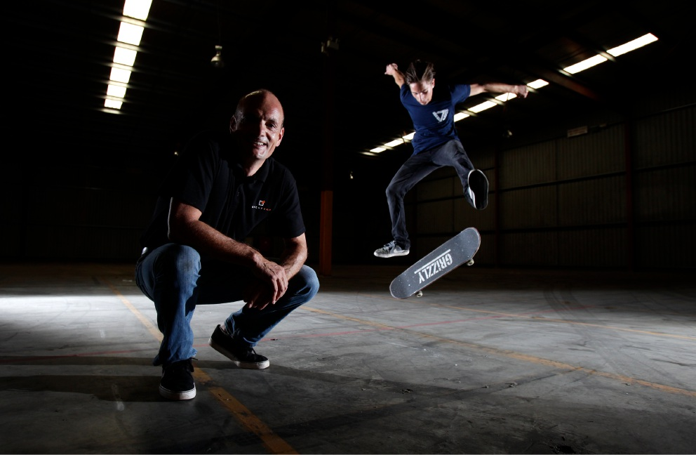 Businessman Richard Kettle (Founder Stompbox) and his son Euan Kettle (16) on skateboard. Picture: Marie Nirme d451983