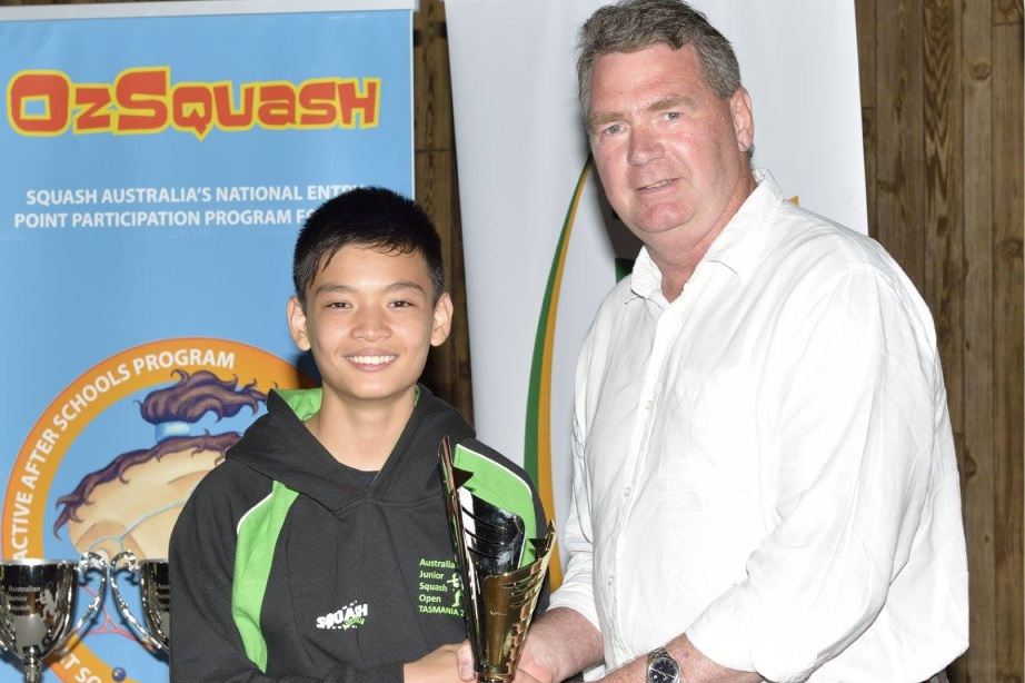 Greg Chan being presented as Under-13s Australian Squash Champion.