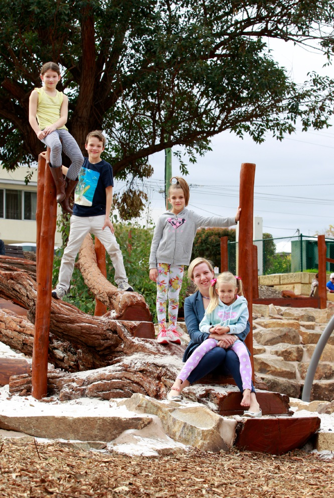 Deputy Mayor City of Bayswater Stephanie Coates at the new nature playground with her children Oliver (9), Claudia (7, grey top) and Esther (5, in lap) and her niece Amy Dancewicz (9, yellow top) Picture: Marie Nirme