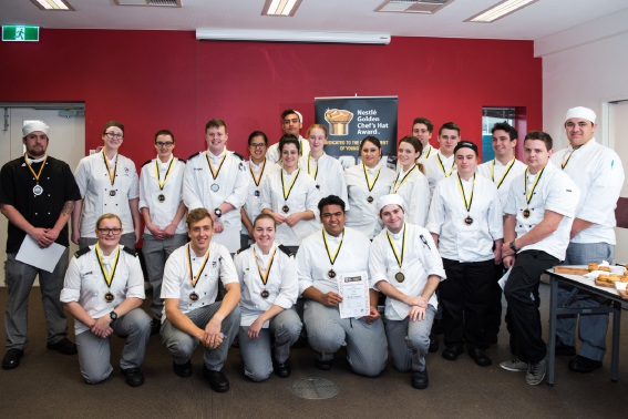 The winning chefs pose with their medals and other awards.