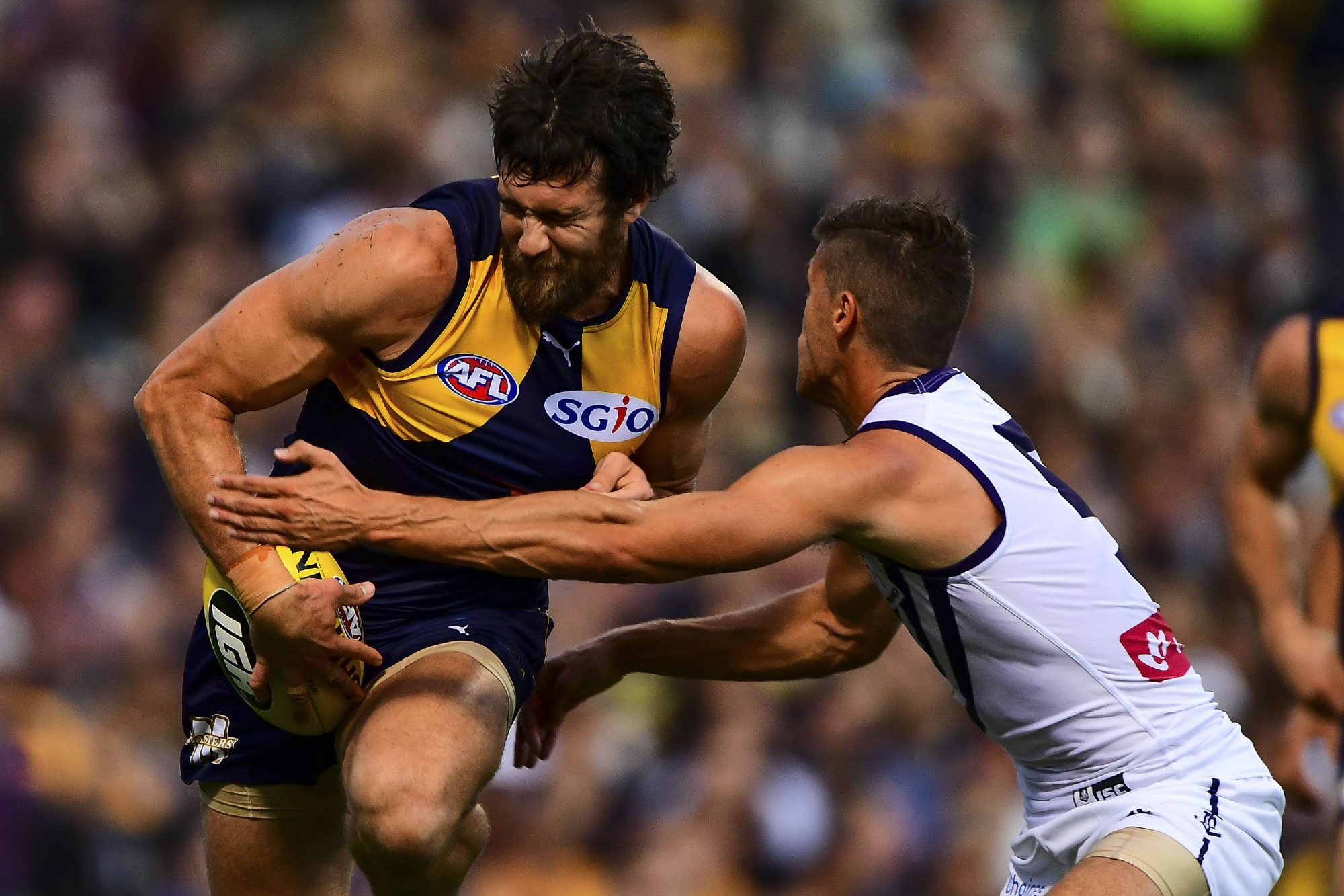 Josh Kennedy breaks past a tackle from Garrick Ibbotson during Derby 43 on Saturday night. Picture: Daniel Carson/AFL Media/Getty Images