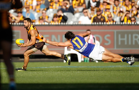 Paul Puopolo of the Hawks is tackled by Josh Kennedy of the Eagles during the 2016 AFL Round 2 match between the Hawthorn Hawks and the West Coast Eagles at the Melbourne Cricket Ground. Picture: Michael Willson/AFL Media/Getty Images