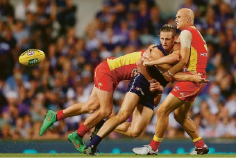 Nat Fyfe is the meat in a Gold Coast sandwich. Picture: Paul Kane/Stringer