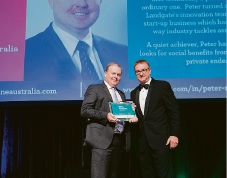Landgate CEO Mike Bradford presents the award to Peter Markham.