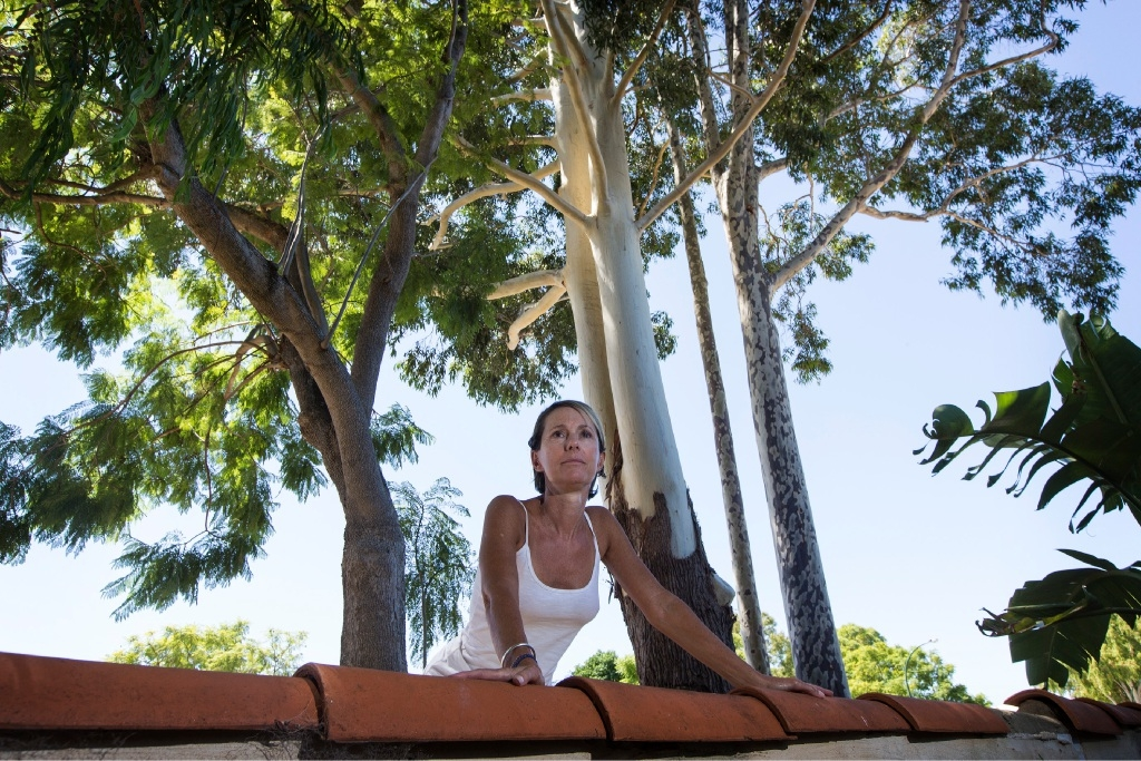 Donna Cox stands at her cracked wall under the rose gum tree. Picture: Will Russell