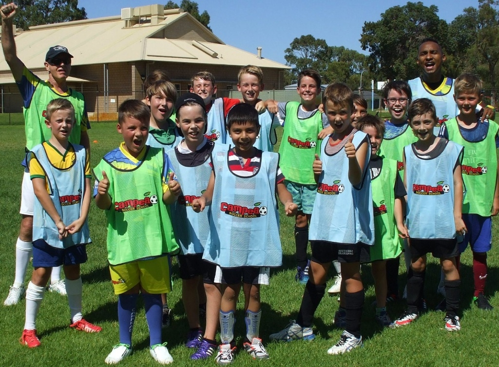 Mandurah FC player Santos with Campeao Soccer School students.