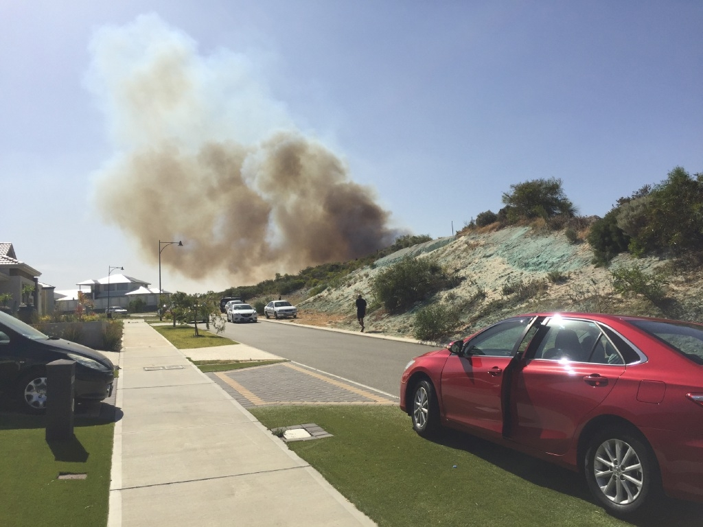 The fire in Jindalee this afternoon. Picture: Martin Kennealey