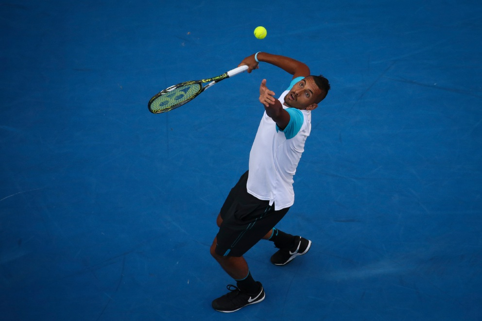 Nick Kyrgios serves in last night's Hopman Cup match against Great Britain's Andy Murray. Picture: Andrew Ritchie. d448399