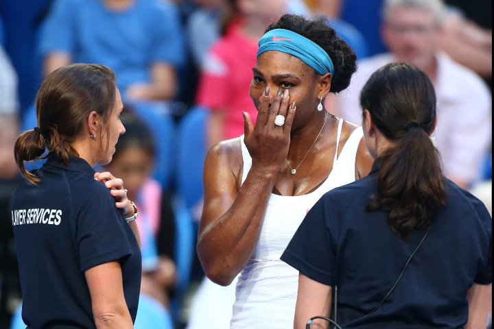 Serena Williams talks to player services staff as she retires injured from her match against Australian Jarmila Wolfe. Picture: Paul Kane/Getty Images