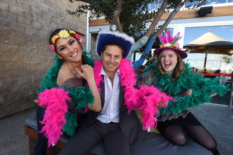 Anara Kurbanova (Little Creatures), Dylan Smith (Impact100) and Hannah Fitch-Rabbitt (Impact100) get their feathers on for Freo de Janeiro. Picture: Jon Hewson        www.communitypix.com.au   d457013